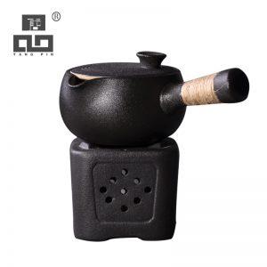 Black crockery ceramic tea warmer and matching tea pot
